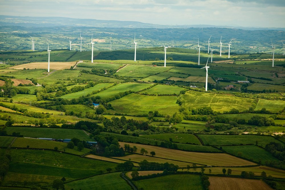 Beautiful green landscape with windmills viewed from the air