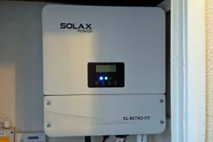 One of our PowerBanx SolaX inverters installed in a hall cupboard (Image: Tanjent)