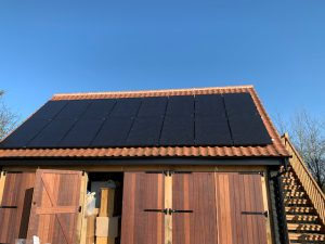 Solar panels installed on the garage roof for Mr RM, Colchester (CO6), Essex