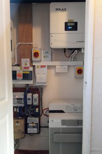 Mr SN's battery storage system in his hall cupboard