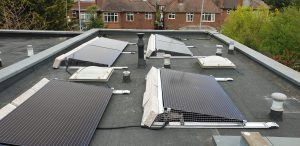 Solar panels installed on a flat roof for Mr PS near Dollis Hill, London (NW2)
