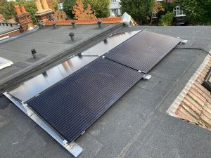 and panels in an east-west configuration on a flat roof